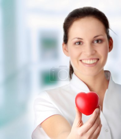 Young nurse with heart